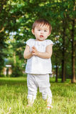 Portrait of asian baby clapping her hands Royalty Free Stock Photo