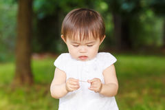 Portrait of asian baby playing Royalty Free Stock Photography