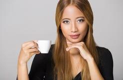 Asian beauty having coffee. Stock Photos