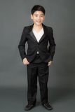 Portrait of asian boy in a Business Suit, Stock Photography