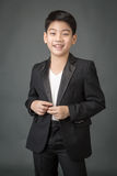 Portrait of asian boy in a Business Suit, Royalty Free Stock Images