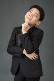 Portrait of asian boy in a Business Suit think of idea Stock Images
