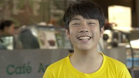 Portrait of asian boy in cafe looking at camera with smile face. stock video