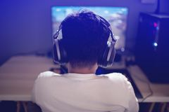 Portrait of asian boy gamer playing games on computer in the room at home stock image