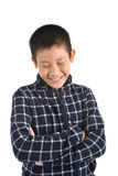 Portrait of Asian boy laughing on white background Royalty Free Stock Photos