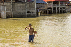 Portrait of the asian boy swimming in the river. Children are swimming in dirty river. They are happy and smile Royalty Free Stock Photos
