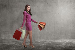 Portrait of asian business woman with shopping bags walking in t Stock Photography