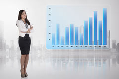 Portrait of asian business woman standing beside virtual graph Royalty Free Stock Photo