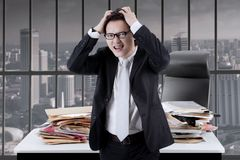 Asian businessman looks stressful in the office Stock Photos