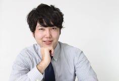 Smiling Asian businessman. Portrait of an Asian businessman royalty free stock photos