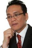 Portrait Asian businessman thinking Stock Photography