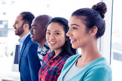 Portrait of Asian businesswoman with colleagues Royalty Free Stock Images