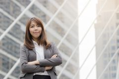 Portrait Of Asian Businesswoman. Outside Office and standing proud and successful in suit royalty free stock photo