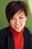 Portrait of an Asian busineswoman at work. Portrait of an Asian busineswoman smiling at work Stock Photos