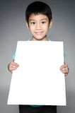 Portrait of Asian child with blank plate for add your text . Stock Photo