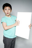 Portrait of Asian child with blank plate for add your text . Stock Photos