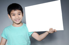 Portrait of Asian child with blank plate for add your text . Stock Photography