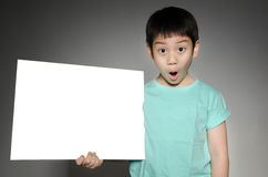 Portrait of Asian child with blank plate for add your text . Royalty Free Stock Images