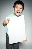 Portrait of Asian child with blank plate for add your text . Royalty Free Stock Photo