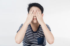 Portrait of asian child upset and close your eye by hand . Stock Image
