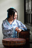 Portrait of Asian Chinese girl in traditional dress, wear blue and white porcelain style Hanfu, carry a food box in a old kitchen. Asian Chinese girl in Royalty Free Stock Image