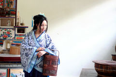 Portrait of Asian Chinese girl in traditional dress, wear blue and white porcelain style Hanfu, carry a traditional food box. Asian Chinese girl in traditional Stock Image