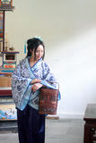 Portrait of Asian Chinese girl in traditional dress, wear blue and white porcelain style Hanfu, carry a traditional food box. Asian Chinese girl in traditional Royalty Free Stock Images