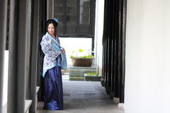 Portrait of Asian Chinese girl in traditional dress, wear blue and white porcelain style Hanfu. Asian Chinese girl in traditional dress, wears blue and white Royalty Free Stock Photos