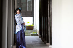 Portrait of Asian Chinese girl in traditional dress, wear blue and white porcelain style Hanfu Royalty Free Stock Photos