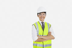 Portrait of Asian construction worker with arms crossed over white background Stock Photo
