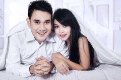 Portrait of asian couple on bed Royalty Free Stock Images