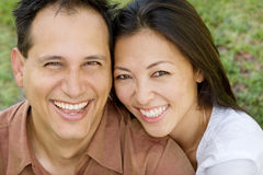 Portrait of an Asian couple laughing and hugging. Royalty Free Stock Photos