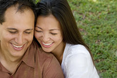 Portrait of an Asian couple laughing and hugging. Stock Image