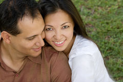 Portrait of an Asian couple laughing and hugging. Royalty Free Stock Images