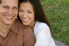 Portrait of an Asian couple laughing and hugging. Royalty Free Stock Photography