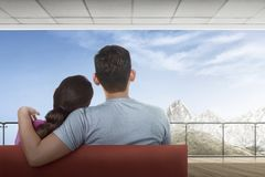 Portrait of asian couple sitting and enjoying mount view. From balcony stock photography
