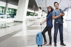 Portrait of asian couple with suitcase and backpack going to tra Royalty Free Stock Image