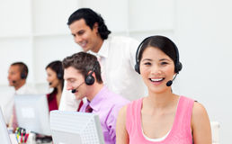 Portrait of an Asian customer agent and her team Stock Photography