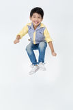 Portrait of asian cute boy is jumping Stock Photo