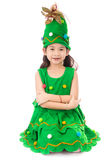 Portrait of asian cute girl in CHRISTMAS TREE costume. Portrait of asian cute girl in CHRISTMAS TREE costume on white background Stock Photo
