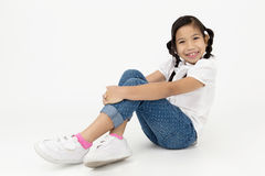Portrait of asian cute girl sitting with smile face Royalty Free Stock Photo