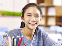 Portrait of asian elementary school student. Portrait of 11-year-old asian elementary schoolgirl royalty free stock photo