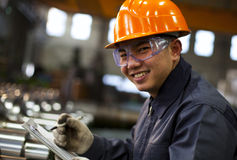 Portrait asian engineer. Asian engineer marking his checklist smile looking on camera ( shallow focus Stock Image