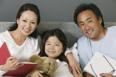 Portrait of an Asian family in bed at home Royalty Free Stock Photos