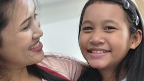 Portrait of asian family mother and daughter smiling and looking at camera stock video