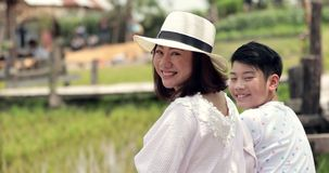 Portrait of asian family mother and son in farm stock footage