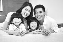 Portrait of an asian family with two children. Happy and smiling, black and white stock image