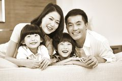 Portrait of an asian family with two children. Happy and smiling, black and white sepia royalty free stock images