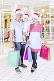 Asian family wearing Santa hat in the store Royalty Free Stock Image