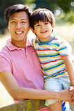 Portrait Of Asian Father And Son In Countryside Stock Images